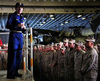 Commander addresses Sailors and Marines aboard USS Boxer during an all-hands call.